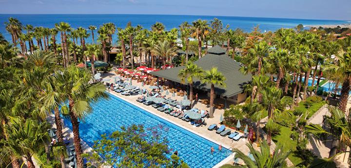 """Šeimos atostogos ant jūros kranto Alanijos regione TURKIJOJE! Savaitės poilsis palmių apsuptyje įsikūrusiame 5* viešbutyje su """"viskas įskaičiuota+""""."""